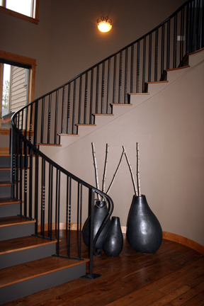 I18 Curved Staircase Railing with Forged Accents